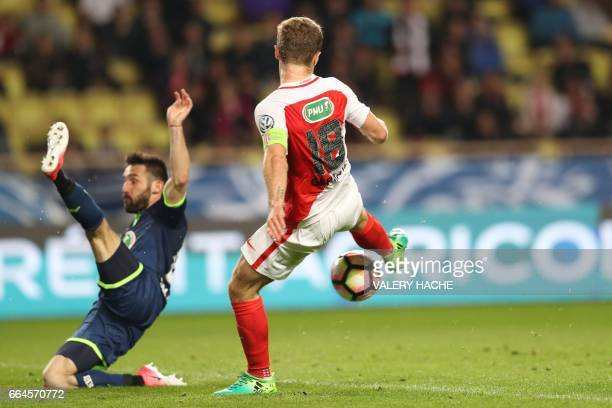 Monaco's French forward Valere Germain shoots and scores a goal during the French Cup football match between Monaco vs Lille at the 'Louis II'...