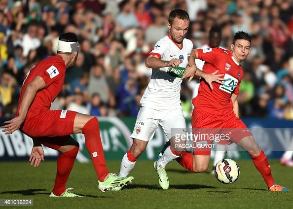 Monaco's French forward Valere Germain vies with Nimes' French midfielder Larry Azouni and Nimes' French defender Anthony Marin during the French Cup...