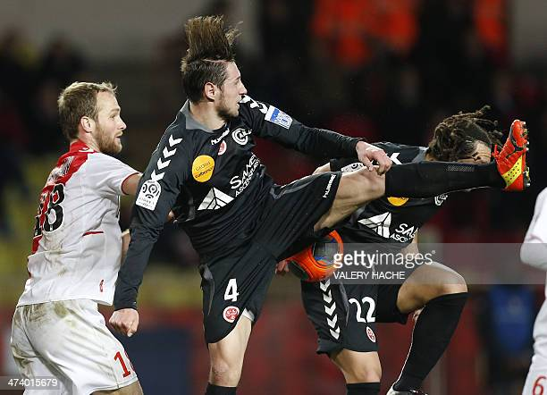 Monaco's French forward Valere Germain vies with Reims' midfielder Grzegorz Krychowiak during the French L1 football match between Monaco and Reims...