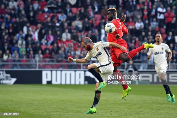 Monaco's French forward Valere Germain vies with Rennes' French defender Joris Gnagnon during the French L1 football match between Rennes and Monaco...