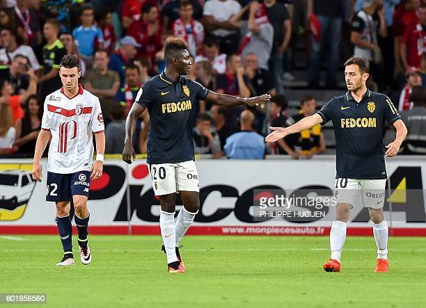 Monaco's French midfielder Adama Traoré celebrates after scoring a goal with team mate Monaco's Portuguese midfielder Bernardo Silva next to Lille's...