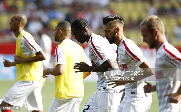 Monaco's French midfielder Geoffrey Kondogbia Monaco's Belgian midfielder Yannick Ferreira Carrasco and Monaco's French forward Valere Germain take...