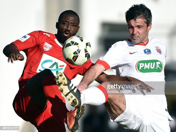 Monaco's French midfielder Jeremy Toulalan vies with Nimes's French forward Anthony Koura during the French Cup football match between Nimes and...