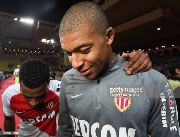 Monaco's French midfielder Thomas Lemar and foward Kylian Mbappe Lottin celebrate their victory at the end of the French L1 football match between...