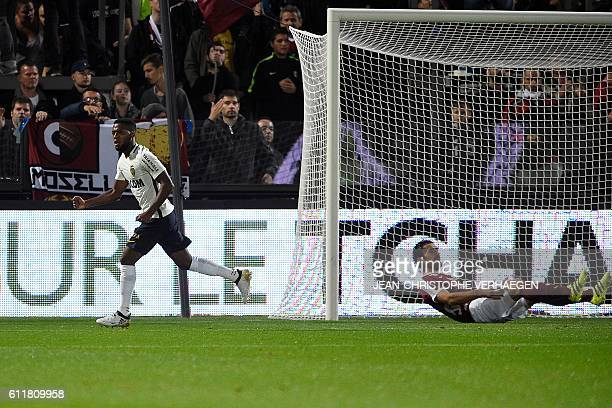 Monaco's French midfielder Thomas Lemar celebrates after scoring a goal during the French L1 football match between Metz and Monaco at the Saint...