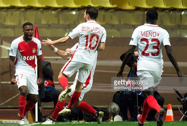 Monaco's French midfielder Thomas Lemar celebrates with his teammates after scoring during the UEFA Champions League group E football match AS Monaco...
