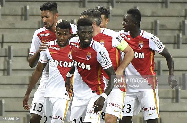 Monaco's French midfielder Thomas Lemar celebrates with teammates after scoring a goal during the French L1 football match between Monaco and...
