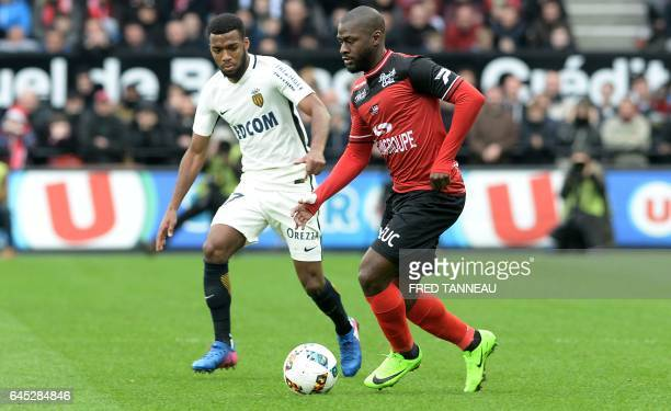 Monaco's French midfielder Thomas Lemar controls the ball past Guingamp's French forward Yannis Salibur during the French L1 football match Guingamp...