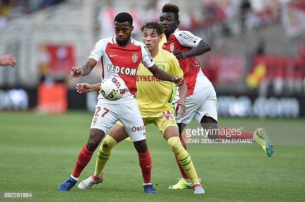 Monaco's French midfielder Thomas Lemar vies for the ball with Nantes' French midfielder Amine Harit during the French L1 football match between FC...