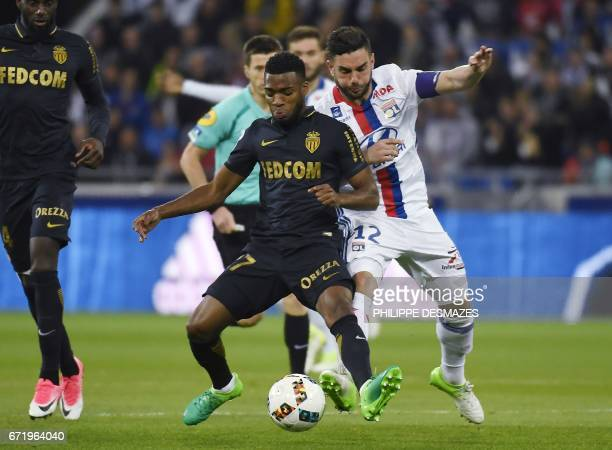 Monaco's French midfielder Thomas Lemar vies with Lyon's French midfielder Jordan Ferri during the French L1 football match Olympique Lyonnais...