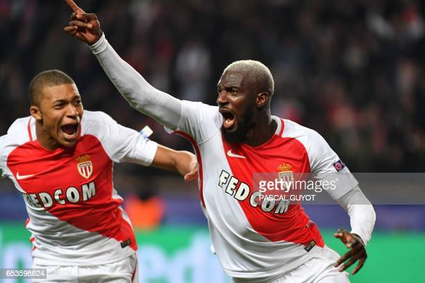 TOPSHOT Monaco's French midfielder Tiemoue Bakayoko celebrates with Monaco's French forward Kylian Mbappe Lottin after scoring a goal during the UEFA...