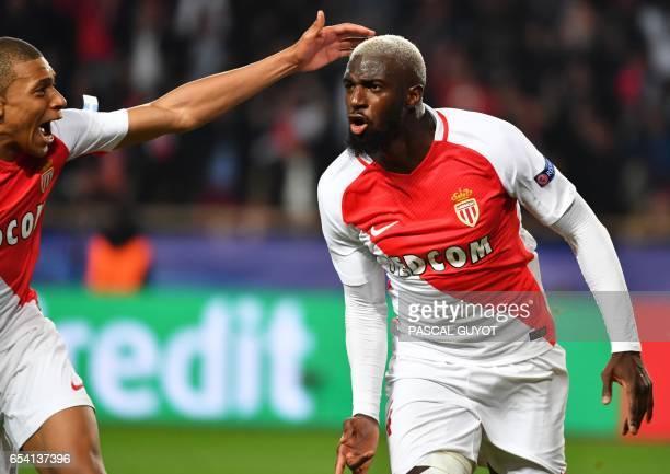 Monaco's French midfielder Tiemoue Bakayoko celebrates with Monaco's French forward Kylian Mbappe Lottin after scoring a goal during the UEFA...