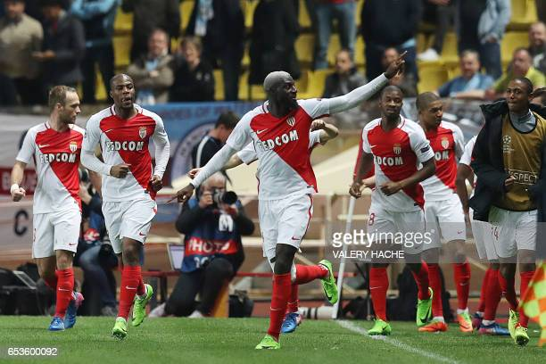 Monaco's French midfielder Tiemoue Bakayoko celebrates with teammates after scoring a goal during the UEFA Champions League round of 16 football...