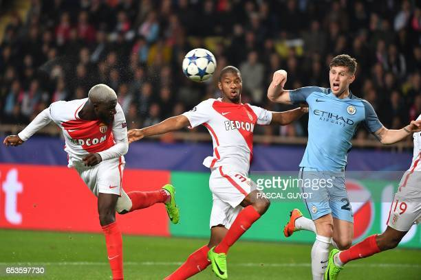 Monaco's French midfielder Tiemoue Bakayoko scores a goal past Manchester City's English defender John Stones during the UEFA Champions League round...