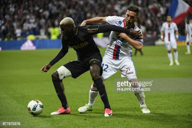 Monaco's French midfielder Tiemoue Bakayoko vies with Lyon's French midfielder Jordan Ferri during the French L1 football match between Olympique...