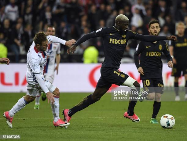 Monaco's French midfielder Tiemoue Bakayoko vies with Lyon's Polish defender Maciej Rybus during the French L1 football match between Olympique...