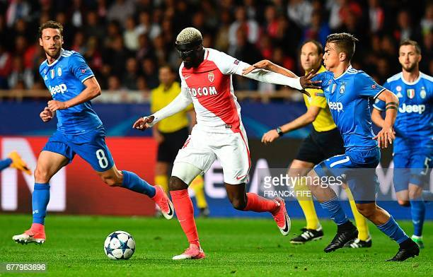 Monaco's French midfielder Tiemoue Bakayokofights for the ball against Juventus' midfielder from Italy Claudio Marchisio and Juventus' forward from...