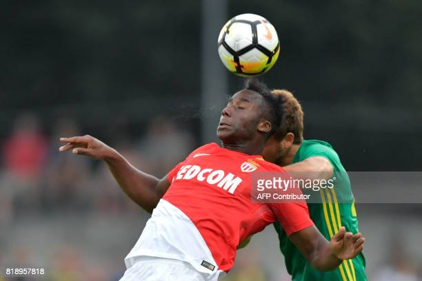 Monaco's French midielder Souhaliho Meite and Fenerbahce's Turkish midfielder Salih Ucan go for a header during a friendly football game between AS...