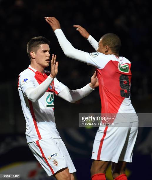 Monaco's Guido Marcelo Carrillo is congratulated by teammates after scoring a goal during the French Cup football match between Chambly and Monaco on...