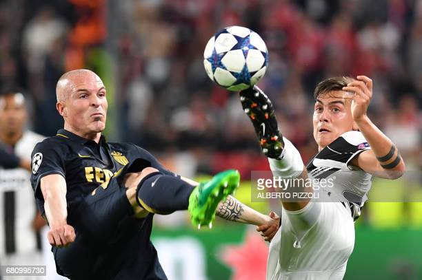 TOPSHOT Monaco's Italian defender Andrea Raggi fights for the ball with Juventus' forward from Argentina Paulo Dybala during the UEFA Champions...