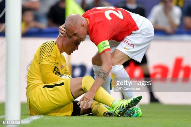 Monaco's Italian defender Andrea Raggi holds Monaco's Swiss goalkeeper Diego Benaglio at the end of an attack during a friendly football game between...