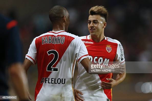 Monaco's Italian forward Stephan El Shaarawy celebrates after scoring a goal with Monaco's Brazilian defender Fabinho during the UEFA Champions...