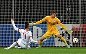 Monaco´s Lucas Ocampos scores against Leverkusen's goalkeeper Bernd Leno during the UEFA Champions League second leg Group C football match Bayer 04...