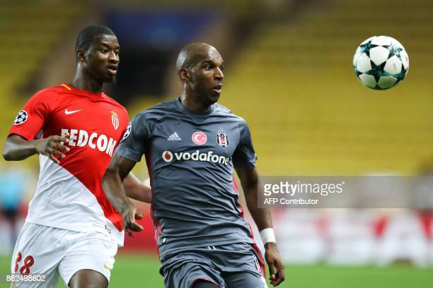Monaco's Malian defender Almamy Toure and Besiktas' Dutch midfielder Ryan Babel eye the ball during the UEFA Champions League group stage football...