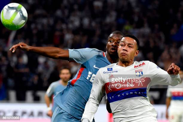 Monaco's Malian defender Almamy Toure fights for the ball against Lyon's Dutch forward Memphis Depay during the French L1 football match between Lyon...