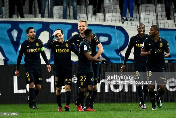 Monaco's midfielder Be Mota Veiga de Carvalho E Silva is congratulated by teammates after scoring a goal during the French L1 football match...