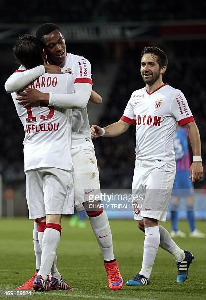 Monaco's midfielder Bernardo Silva is congratulated by Monaco's French forward Anthony Martial and Monaco's Portuguese midfielder Joao Moutinho after...