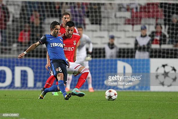 Monaco's midfielder Joao Moutinho vies with Benfica's midfielder Andreas Samaris during the UEFA Champions League match between SL Benfica and AS...