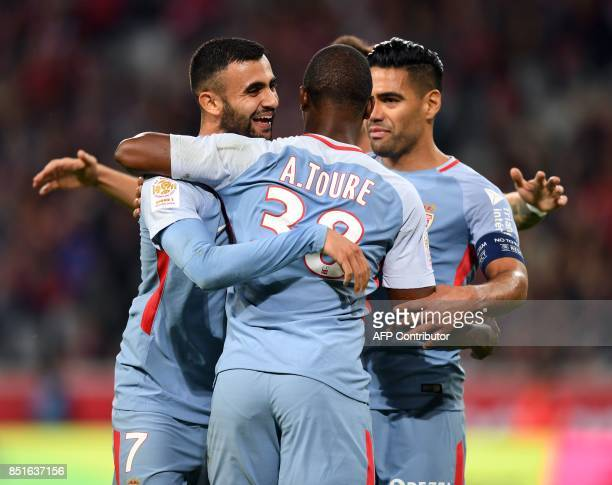 Monaco's midfielder Rachid Ghezzal celebrates with teammates after scoring a goal during the French L1 football match between Lille OSC and Monaco on...