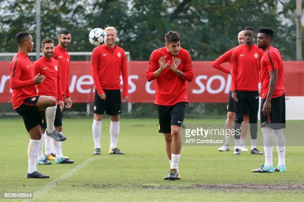 Monaco's Montenegrin forward Stevan Jovetic hides from the ball as he attends a training session with his teammates on the eve of their UEFA...