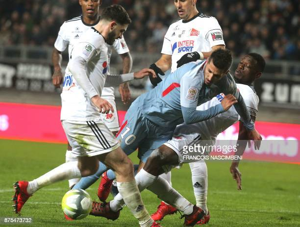 Monaco's Montenegrin forward Stevan Jovetic is tackled during the French L1 football match Amiens vs Monaco on October 17 2017 at the Licorne Stadium...