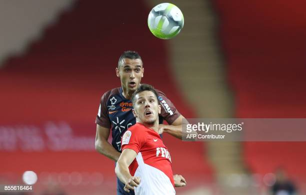 Monaco's Montenegrin forward Stevan Jovetic vies with Montpellier's French midfielder Ellyes Skhiri during the French L1 football match Monaco vs...