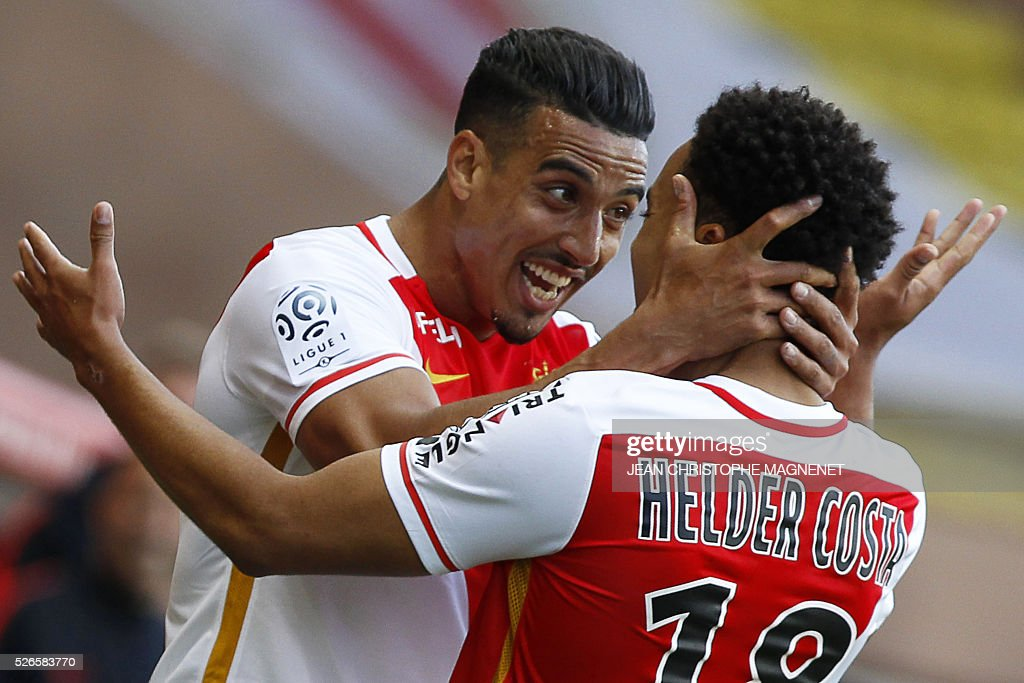 Monaco's Moroccan midfielder Nabil Dirar (L) celebrates with his teammate Monaco's Portuguese forward Helder Costa, after scoring a goal during the French L1 football match Monaco (ASM) vs Guingamp (EAG) on April 30, 2016, at the Louis II stadium in Monaco.