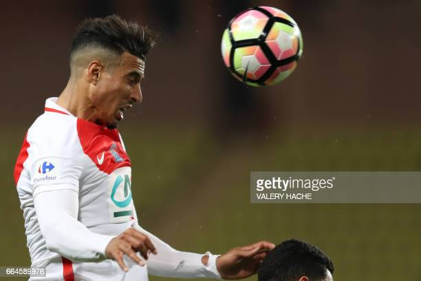 Monaco's Moroccan midfielder Nabil Dirar heads the ball during the French Cup football match between Monaco vs Lille at the 'Louis II' stadium in...