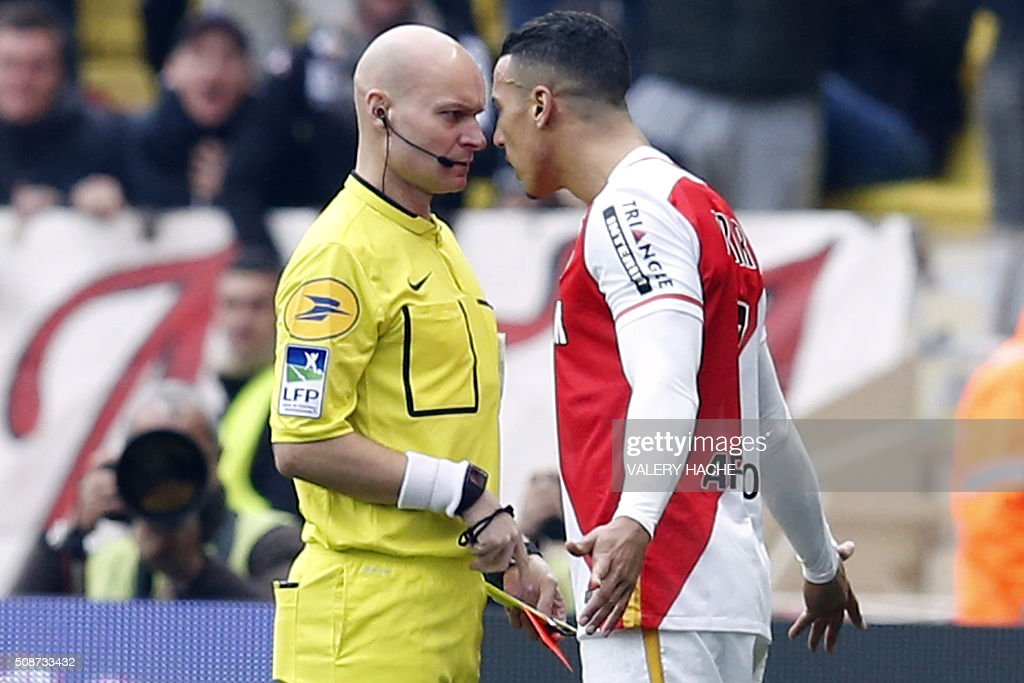 Monaco's Moroccan midfielder Nabil Dirar (R) speaks to referee Tony Chapron after receiving a red card during the French L1 football match between Monaco (ASM) and Nice (OGCN) at Louis II Stadium in Monaco on February 6, 2016. AFP PHOTO / VALERY HACHE / AFP / VALERY HACHE