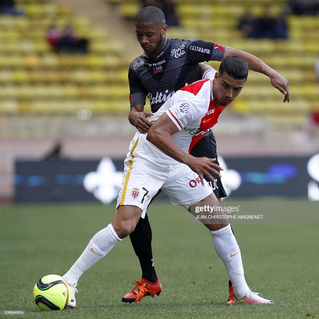 Monaco's Moroccan midfielder Nabil Dirar (R) vies with Guingamp's French defender Marcus Coco (L) during the French L1 football match Monaco (ASM) vs Guingamp (EAG) on April 30, 2016, at the Louis II stadium in Monaco.