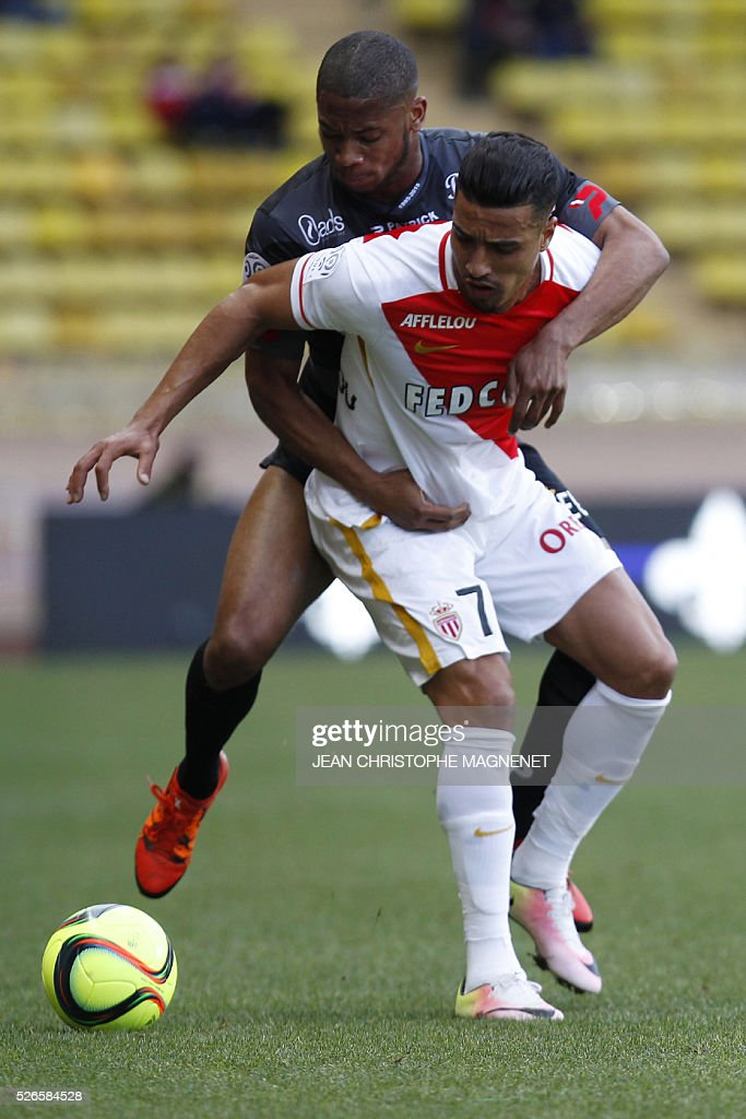 Monaco's Moroccan midfielder Nabil Dirar (R) vies with Guingamp's French defender Marcus Coco during the French L1 football match Monaco (ASM) vs Guingamp (EAG) on April 30, 2016, at the Louis II stadium in Monaco.