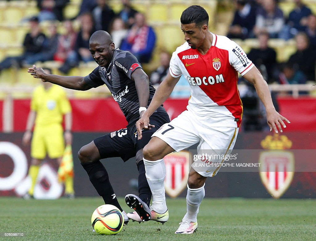 Monaco's Moroccan midfielder Nabil Dirar (R) vies with Guingamp's French midfielder Younousse Sankhare (L) during the French L1 football match Monaco (ASM) vs Guingamp (EAG) on April 30, 2016, at the Louis II stadium in Monaco.