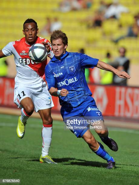 AS Monaco's PierreEmerick Aubameyang and AJ Auxerre's Valter Birsa battle for the ball