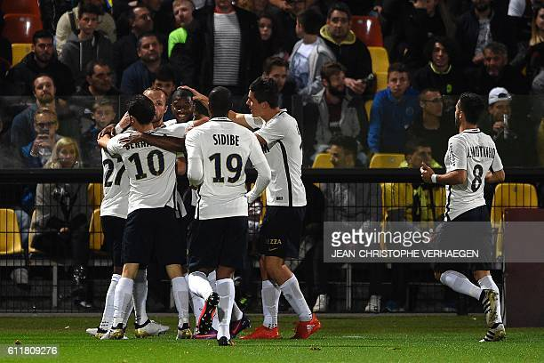 Monaco's players celebrate after scoring a goal during the French L1 football match between Metz and Monaco at the Saint Symphorien stadium in...