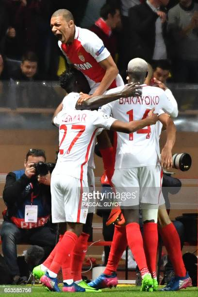 Monaco's players celebrate their second goal during the UEFA Champions League round of 16 football match between Monaco and Manchester City at the...