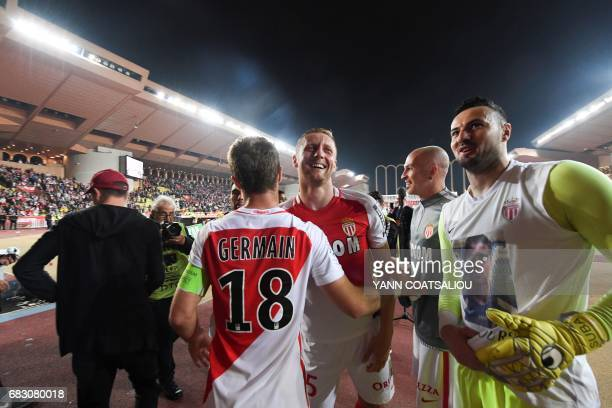 Monaco's players celebrate their victory at the end of the French L1 football match between Monaco and Lille at the Louis II Stadium in Monaco on May...