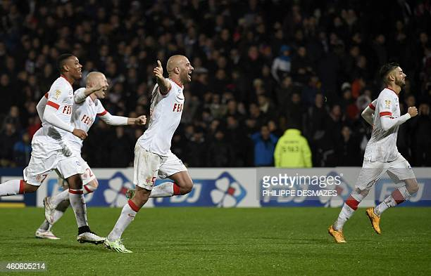 Monaco's players reacts after winning the French League Cup football match Olympique Lyonnais against AS Monaco on December 17 2014 at the Gerland...