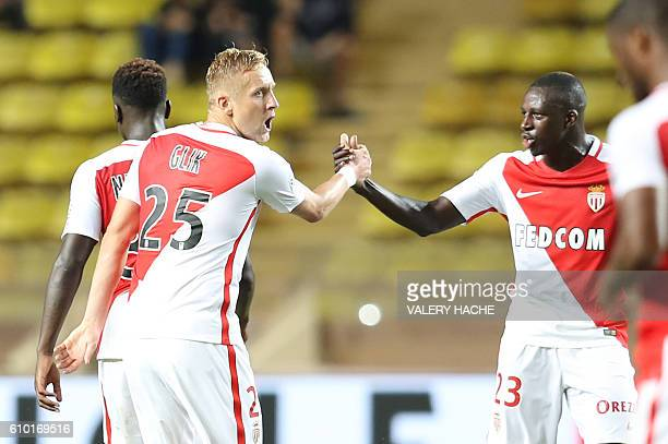 Monaco's Polish defender Kamil Glik celebrates after scoring a goal during the French L1 football match Monaco vs Angers on September 24 2016 at the...