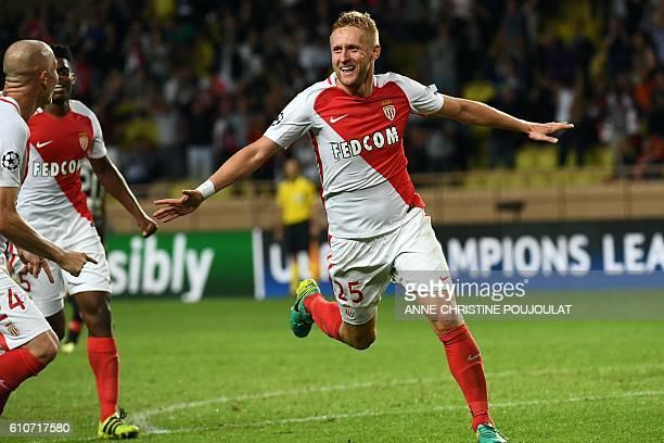 Monaco's Polish defender Kamil Glik celebrates after scoring a goal during the UEFA Champions League football match AS Monaco vs Bayer Leverkusen on...