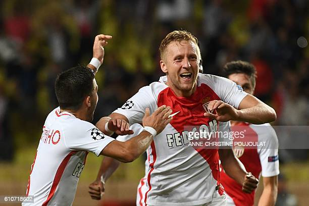Monaco's Polish defender Kamil Glik celebrates after scoring a goal during the UEFA Champions League football match AS Monaco vs Bayer Leverkusen on...